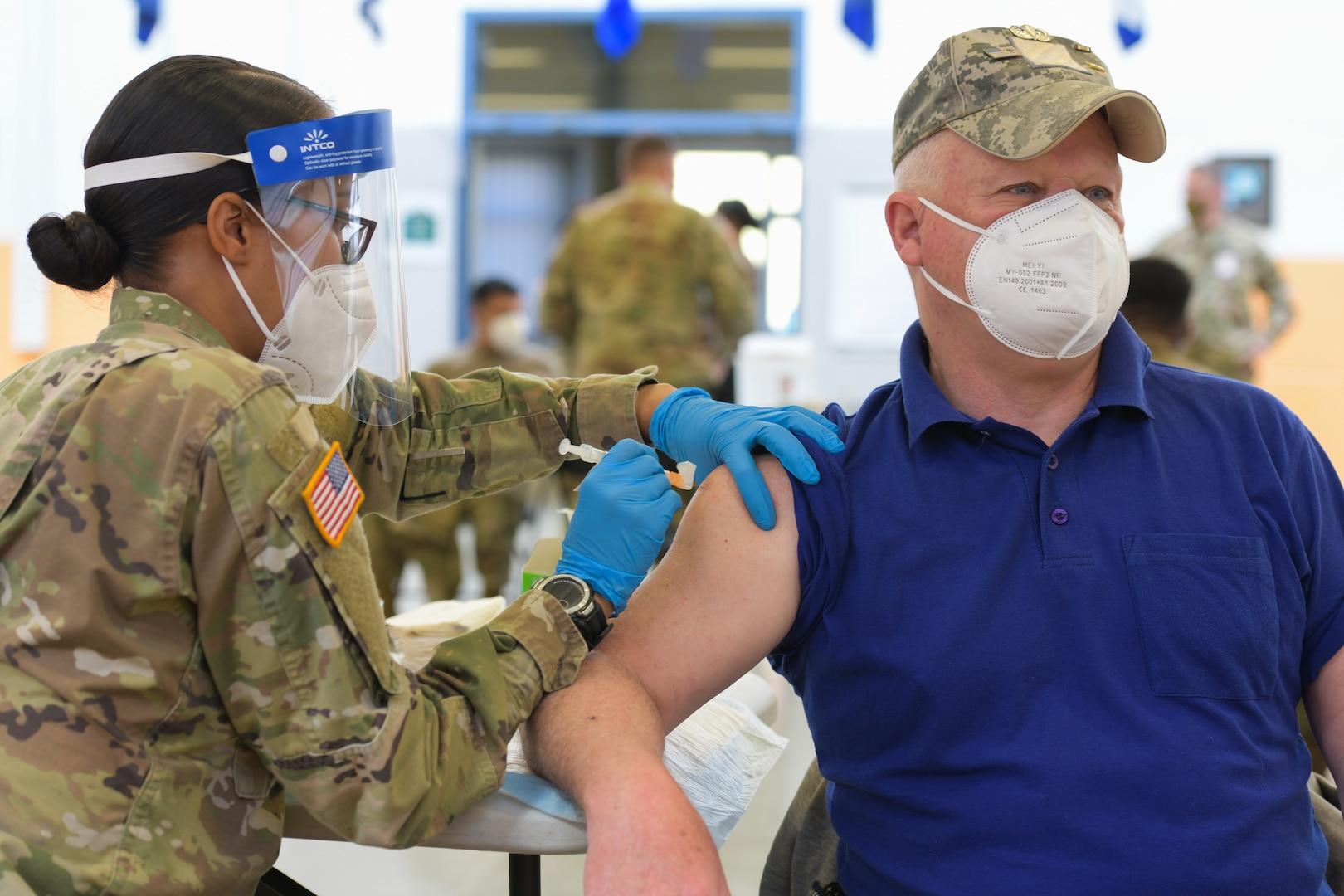 Service member administers COVID-19 vaccine