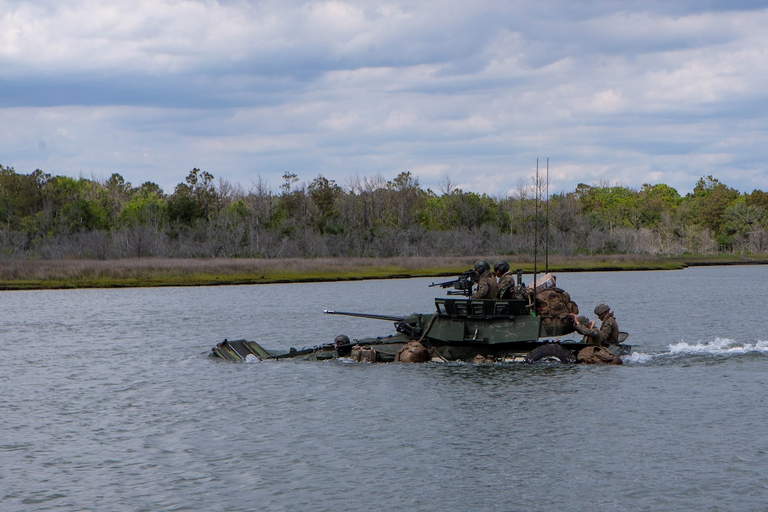 U.S. Marines with Bravo Company, 2d Light Armored Reconnaissance Battalion (2d LAR), 2d Marine Division, participate in a water crossing training event with LAV-25s on Camp Lejeune, N.C., May 17, 2021. This event was a part of the company's Marine Corps Combat Readiness Evaluation (MCCRE). A MCCRE is an exercise designed to formally evaluate a unit's combat readiness and fulfill all required tasks needed to support the Marine Expeditionary Unit. (U.S. Marine Corps photo by Pfc. Sarah Pysher)