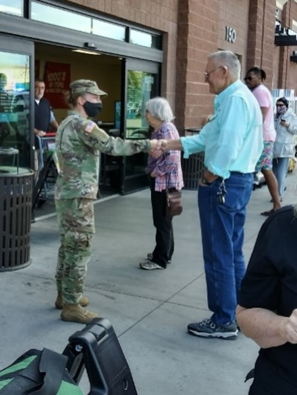 Soldier shakes man's hand
