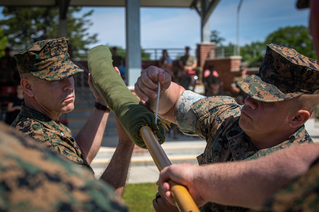 U.S. Marine Corps Lt. Col. Neil Berry, commanding officer, left, and Sgt. Maj. Francisco Ortega, battalion sergeant major, both with 3rd Battalion, 8th Marine Regiment, 2d Marine Division, case the colors during their battalion's deactivation ceremony on Camp Lejeune, N.C., May 18, 2021. The battalion served a total of 70 years and is being deactivated in accordance with the 38th Commandant's Planning Guidance and Force Design 2030. (U.S. Marine Corps photo by Lance Cpl. Brian Bolin Jr.)