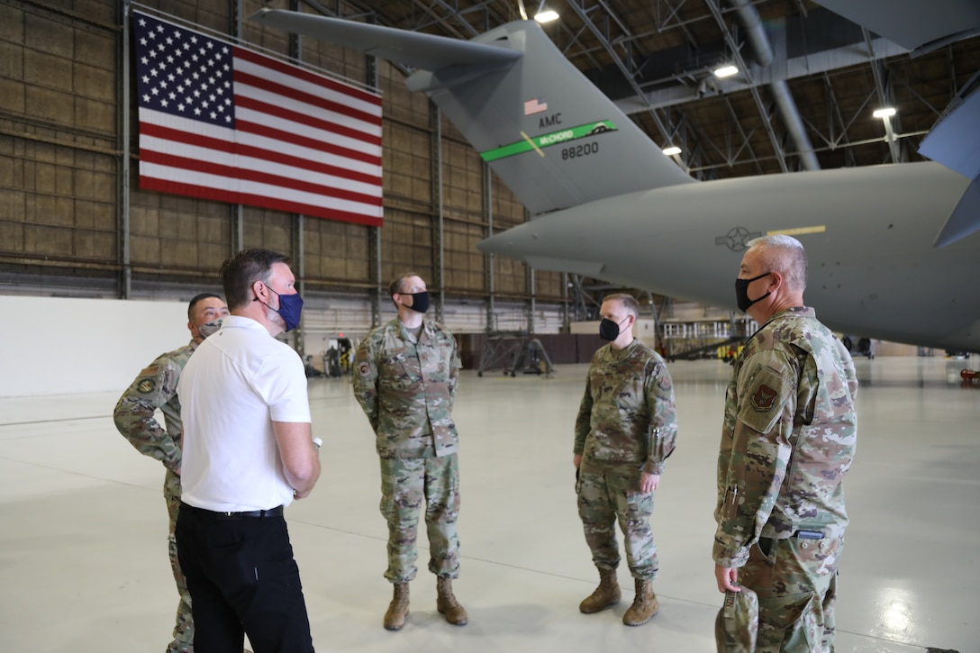 Members of the 446th Maintenance Group discuss C-17 Globemaster III aircraft specifications and maintenance with Mayor Andy Ryder, city of Lacey, Washington, during a visit to the 446th Airlift Wing on May 10, 2021 at Joint Base Lewis-McChord.