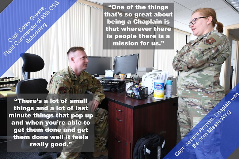 """Capt. Corey Greene (left), Flight Commander of 90th OSS Scheduling, and  Capt. Jessica Prophitt, Chaplain with the 90th Missile Wing, have a conversation at their work station. """"There's a lot of small things and a lot of last minute things that pop up and when you're able to get them done and get them done well it feels really good,"""" said Greene. """"One of the things that's so great about being a Chaplain is that wherever there is people there is a mission for us,"""" said Prophitt."""
