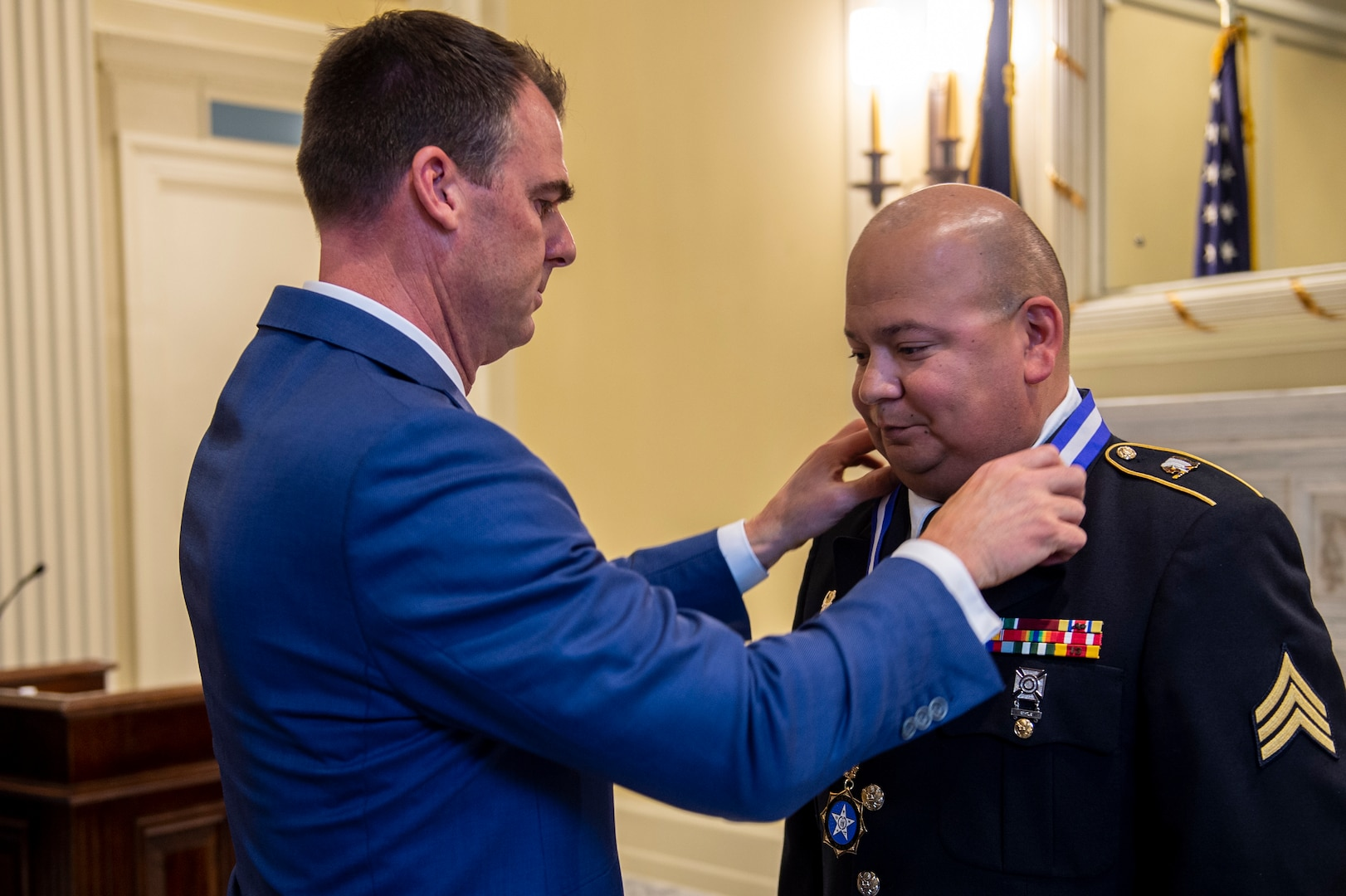 Governor Kevin Stitt presents Oklahoma Army National Guard Sgt. Pedro Gonzales III with the inaugural Oklahoma Medal of Valor during a ceremony at the Oklahoma State Capitol in Oklahoma City, May 18, 2021. The Oklahoma Medal of Valor is the state of Oklahoma's highest award of honor presented to a member of a public safety agency or member of the public. (Oklahoma National Guard photo by Anthony Jones)