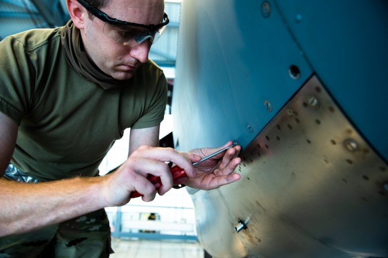 U.S. Air Force Tech. Sgt. Gregory Kolb, 86th Maintenance Squadron dock coordinator, secures the panel of a C-130J Super Hercules aircraft engine at Ramstein Air Base, Germany, Nov. 16, 2020. A seven-level technician must verify the correct installation of the engine panels before the aircraft is cleared to fly. (U.S. Air Force photo by Airman 1st Class Andrew J. Alvarado)