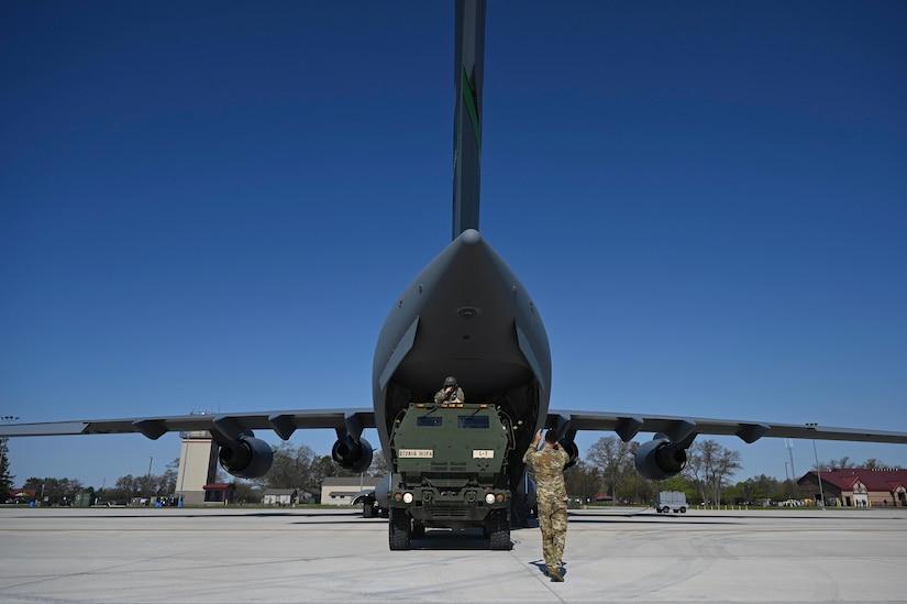 Airmen load an aircraft.
