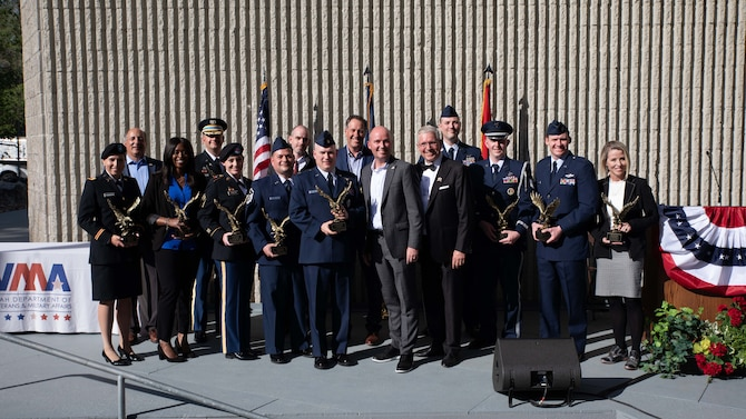 Recipients of the State of Utah Servicemembers of the Year awards pose for a group photo with Utah Gov. Spencer Cox.