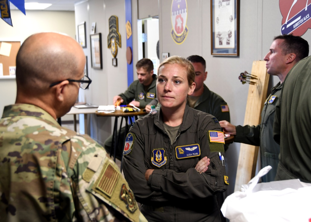 Capt. Alexa Pearl, 700th Airlift Squadron, speaks with Lt. Col. Antonio Ortiz-Guzman, 94th Airlift Wing chaplain, at Dobbins Air Reserve Base, Georgia, during a luncheon for Airmen.