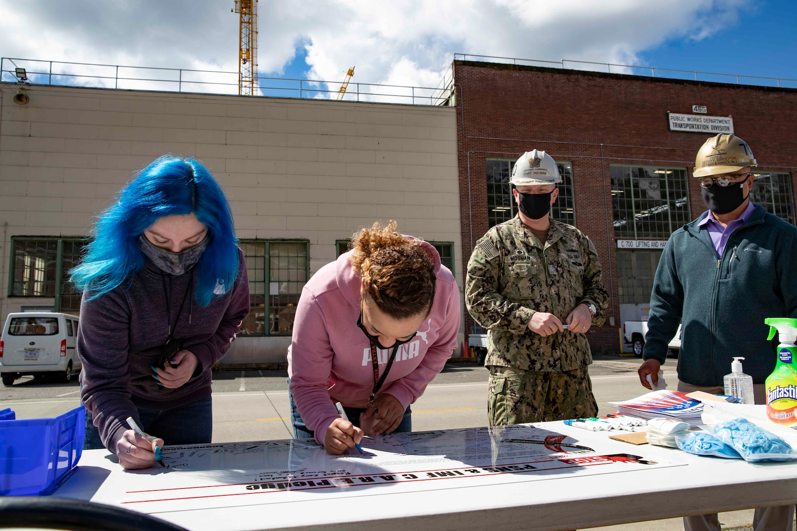 Puget Sound Naval Shipyard & Intermediate Maintenance Facility leaders and employees signed C.A.R.E. pledges and banners during two events May 18, 2021, at locations throughout the shipyard in Bremerton, Washington.