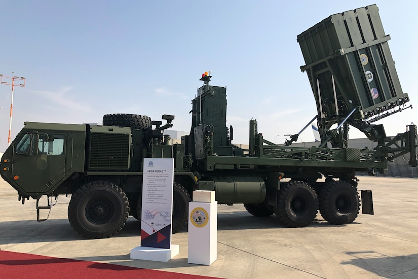 Iron Dome missile system is on display on a tarmac.