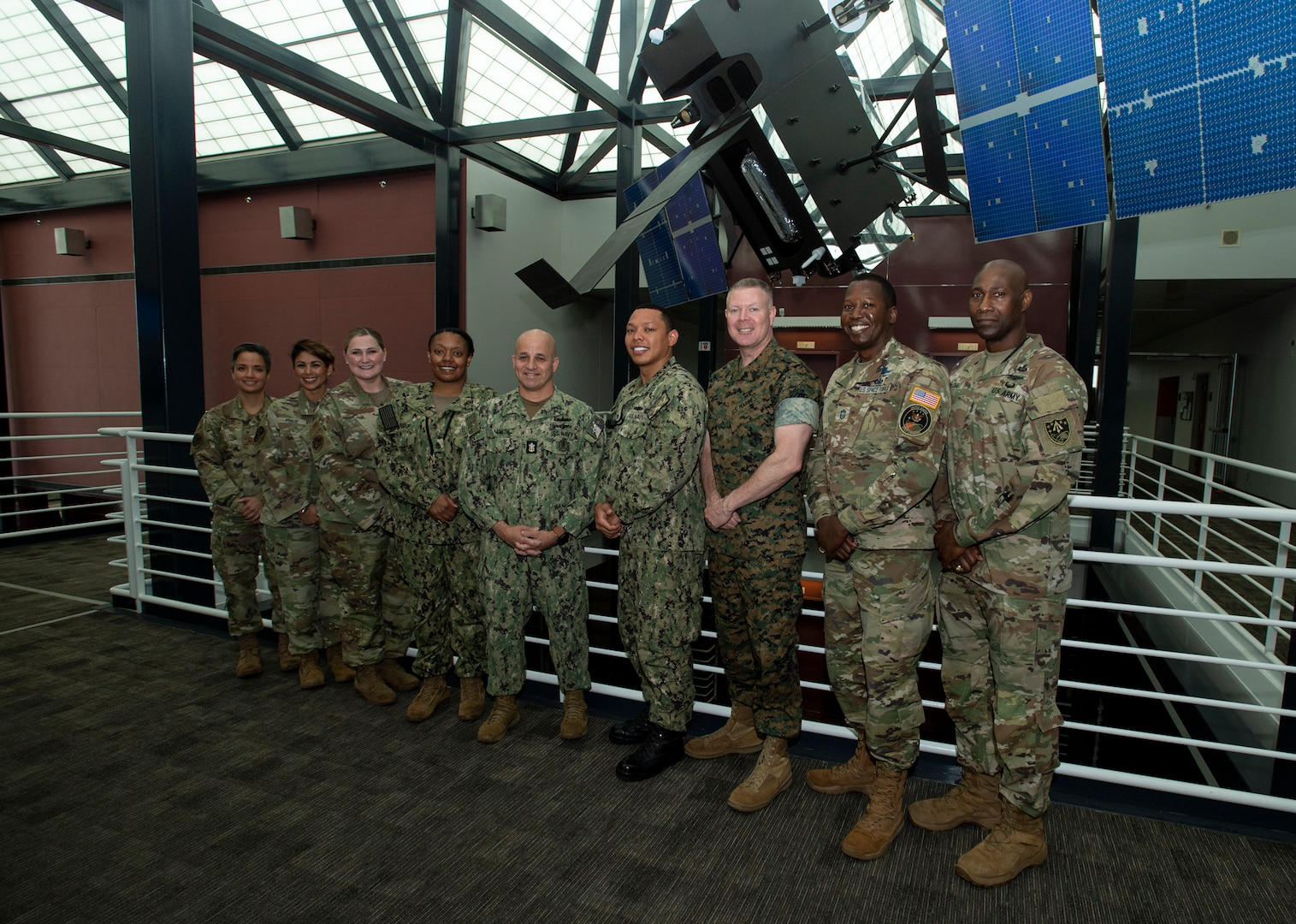 Military officials pose for a photo.