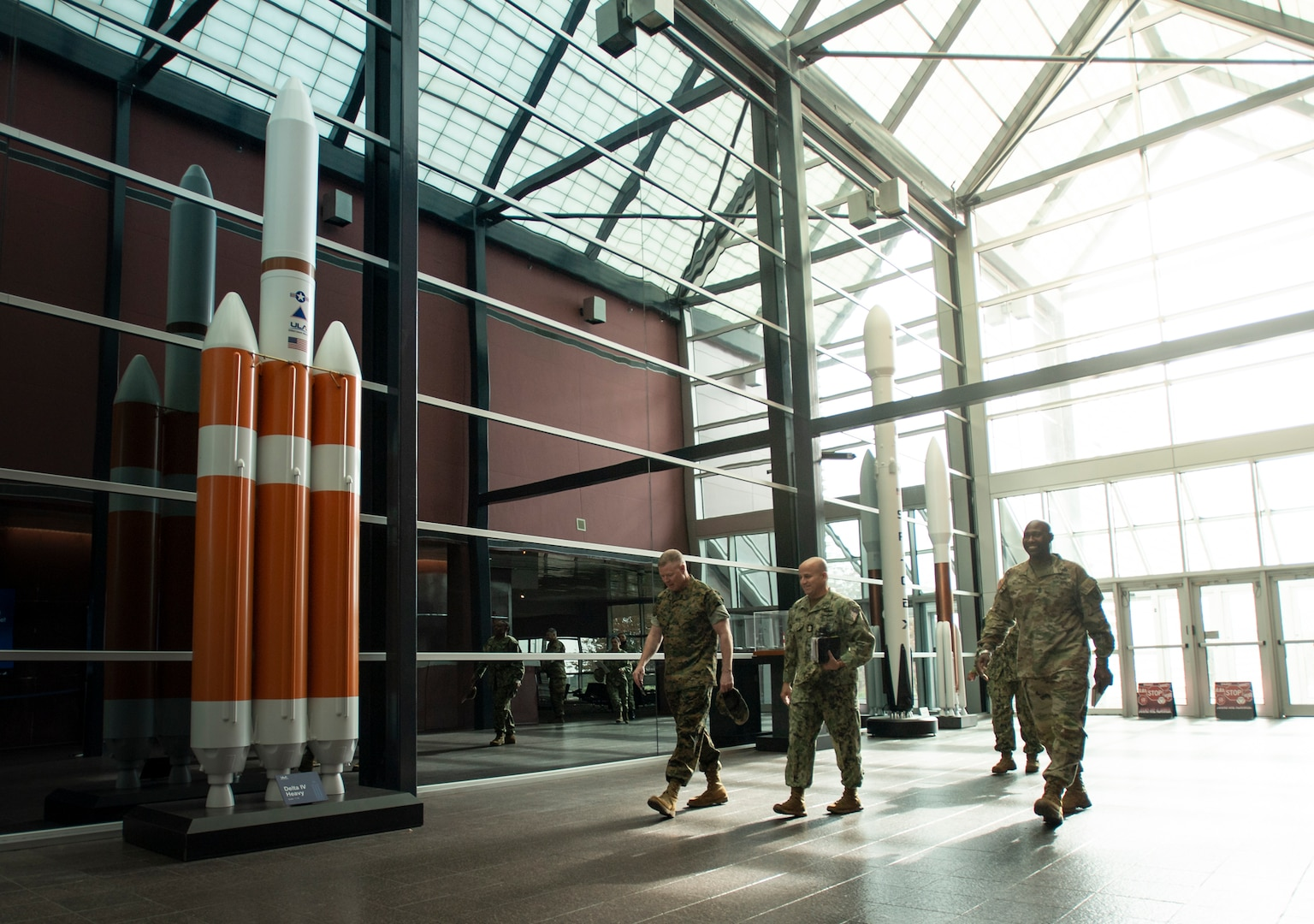Military officials walk into a building