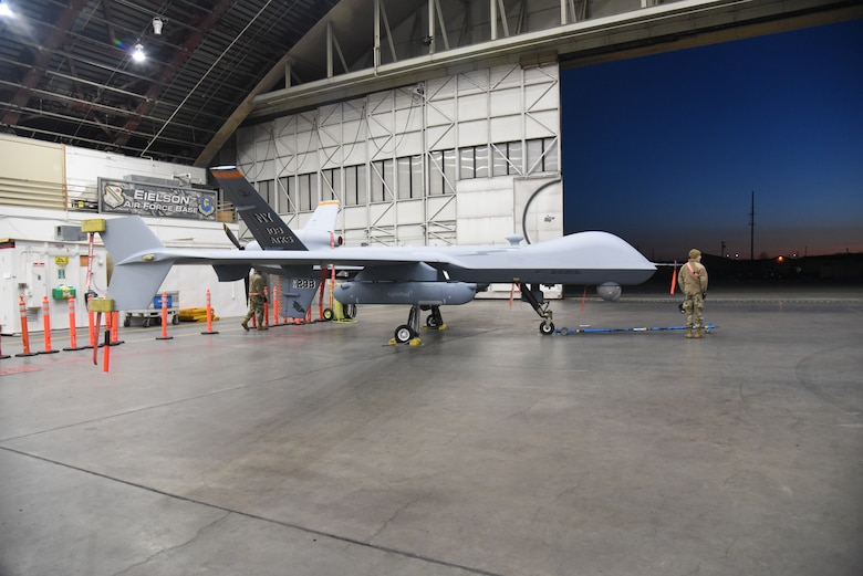 A 174th Attack Wing MQ-9 Reaper prepares for flight at Eielson Air Force Base during exercise Northern Edge 21. The 174th has partnered with multiple DoD contractors and academia to lead the effort in establishing new and additional capabilities for the MQ-9 Reaper. This two-week long exercise that took place from May 3-15. Northern Edge is Alaska's premier joint-training exercise designed to practice operations and enhance interoperability among the services. (U.S. Air National Guard photo by Airman 1st Class Tiffany Scofield )