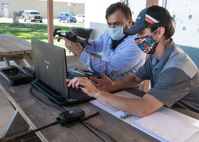 Julio Toala, Air Force Civil Engineer Center GeoBase program geospatial operations manager, receives training from Joseph Campbell, Emerging Technologies Institute chief technology officer and lead instructor, on drone pre-flight checks at San Geronimo Air Park, Texas, May 7, 2021. The training focused on pre- and post-flight checks, projecting flight patterns and 3D mapping using images from the drone. The Air Force GeoBase mission is to create and exploit geospatial information and services to optimize agile combat support and minimize operational risk.