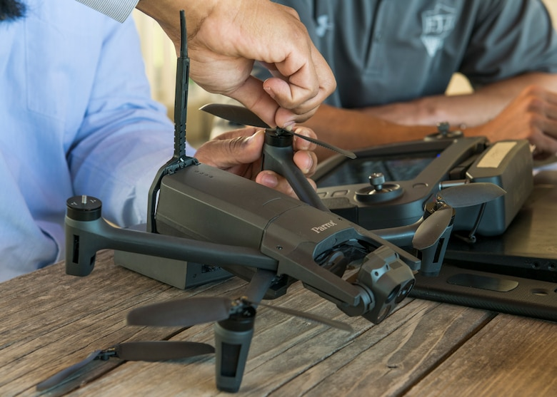 The student inspects and changes out propellers on a drone during pre-flight checks during Air Force Civil Engineer Center GeoBase program drone training at San Geronimo Air Park, Texas, May 7, 2021. The training focused on pre- and post-flight checks, projecting flight patterns and 3D mapping using images from the drone. The Air Force GeoBase mission is to create and exploit geospatial information and services to optimize agile combat support and minimize operational risk.