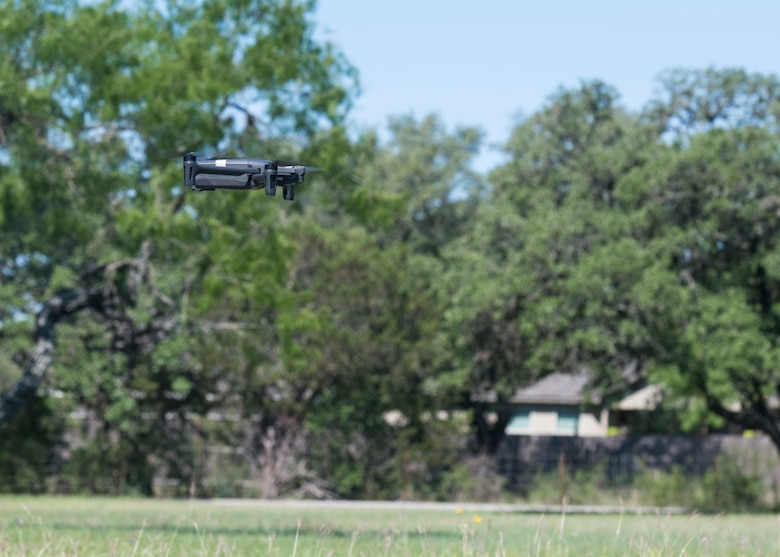 A drone takes flight as members of the Air Force Civil Engineer Center GeoBase program go through drone training at San Geronimo Air Park, Texas, May 7, 2021. The training focused on pre and post-flight checks, projecting flight patterns and 3D mapping using images from the drone. The Air Force GeoBase mission is to create and exploit geospatial information and services to optimize agile combat support and minimize operational risk.