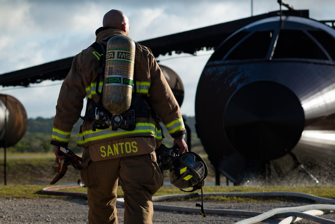 Rusty Santos, firefighter assigned to the 36th Civil Engineer Squadron, gears up for a joint live fire training at Andersen Air Force Base, Guam, May 11, 2021.