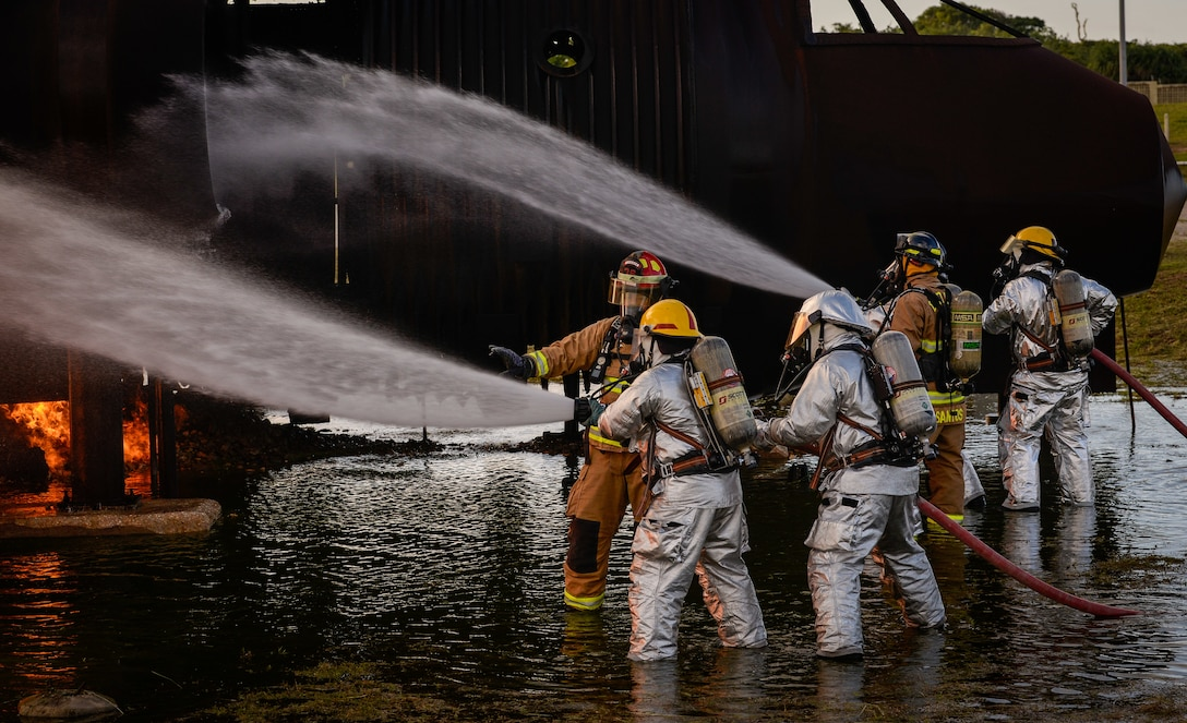 U.S. Air Force and Palau firefighters put out a simulated aircraft fire during joint aircraft fire training at Andersen Air Force Base, Guam, May 11, 2021.