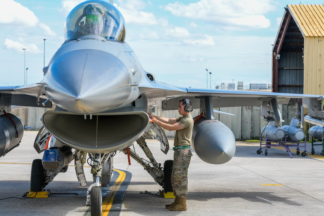 Senior Airman Juan Monroy, 555th Aircraft Maintenance Unit F-16 Fighting Falcon crew chief, provides post-flight operations on an F-16 participating in Astral Knight 2021 (AK21) at Aviano Air Base, Italy, May 18, 2021. Eight F-16s assigned to the 555th Fighter Squadron are participating in AK21, which is a joint, multinational exercise designed to test integrated air and missile defense capabilities. AK21 involves approximately 1900 combined joint force members from the Albanian, Croatian, Hellenic, Italian and Slovenian militaries. (U.S. Air Force photo by Airman 1st Class Brooke Moeder)