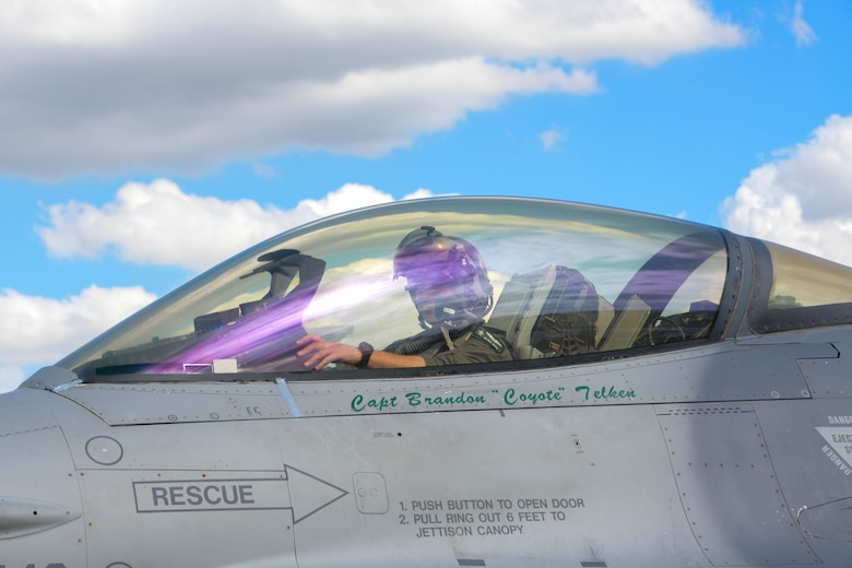 U.S. Air Force Capt. Russell Main, 555th Fighter Squadron F-16 Fighting Falcon pilot, sits in an F-16 after flying in Astral Knight 2021 (AK21) at Aviano Air Base, Italy, May 18, 2021. AK21 involves approximately 1900 combined joint force members from the Albanian, Croatian, Hellenic, Italian and Slovenian militaries. The participating aircraft include the U.S. Air Force F-15E Strike Eagle, F-16, HH-60 Pave Hawk and C-130J Super Hercules aircraft, Italian air force F-35 Lightning II aircraft, Hellenic air force F-16 and Emb-145 Erieye aircraft, and Croatian air force MiG-21 BisD/UMD aircraft. (U.S. Air Force photo by Airman 1st Class Brooke Moeder)