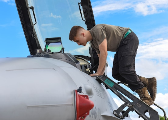 Senior Airman Neil Farbotnik, 555th Aircraft Maintenance Unit F-16 Fighting Falcon crew chief, inspects an F-16 that flew in Astral Knight 2021 (AK21) at Aviano Air Base, Italy, May 18, 2021. Eight F-16s assigned to the 555th Fighter Squadron are participating in AK21, which is a joint, multinational exercise designed to test integrated air and missile defense capabilities. The participating aircraft include the U.S. Air Force F-15E Strike Eagle, HH-60 Pave Hawk and C-130J Super Hercules aircraft, Italian air force F-35 Lightning II aircraft, Hellenic air force F-16 and Emb-145 Erieye aircraft, and Croatian air force MiG-21 BisD/UMD aircraft. (U.S. Air Force photo by Airman 1st Class Brooke Moeder)