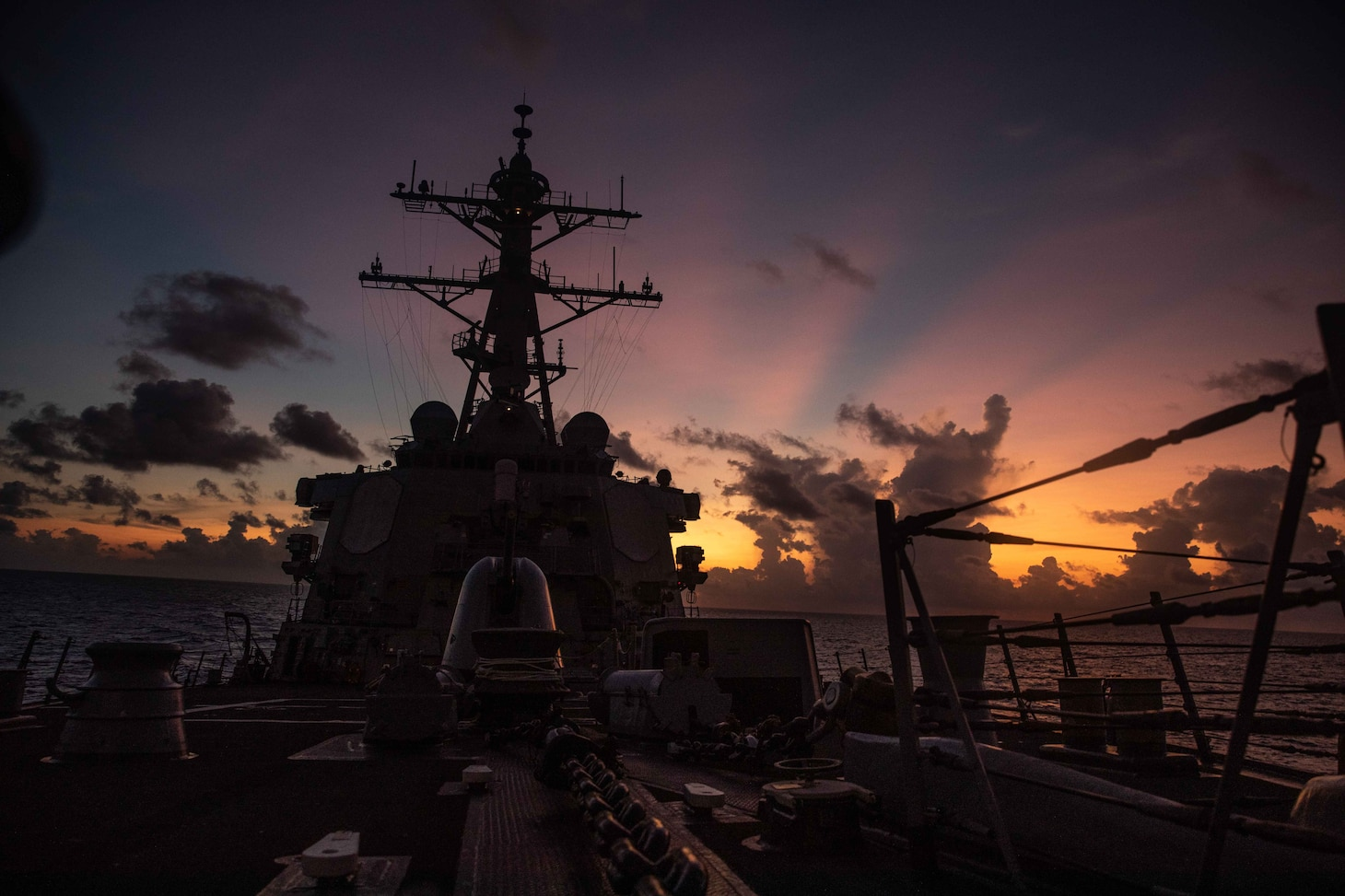 The Arleigh Burke-class guided-missile destroyer USS Curtis Wilbur (DDG 54) conducts routine operations in the South China Sea. Curtis Wilbur is assigned to Commander, Task Force 71/Destroyer Squadron (DESRON) 15, the Navy's largest forward DESRON and the U.S. 7th Fleet's principal surface force.