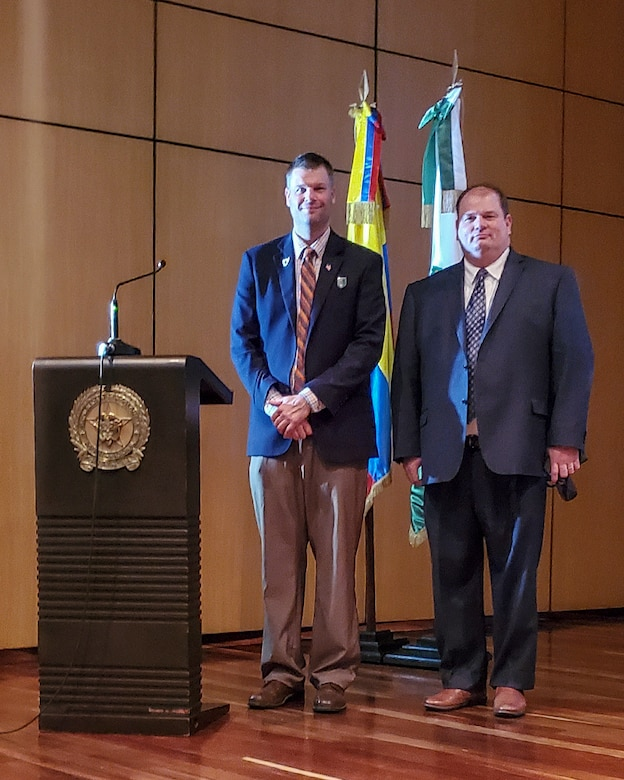 Joseph Kidwell Jr., left, the Senior Central Case Manager, and Jason King, the Country Program Manager, both from U.S. Army Security Assistance Command, pose for a photo after a training class at the Colombian National Police headquarters, in Bogota, Colombia.