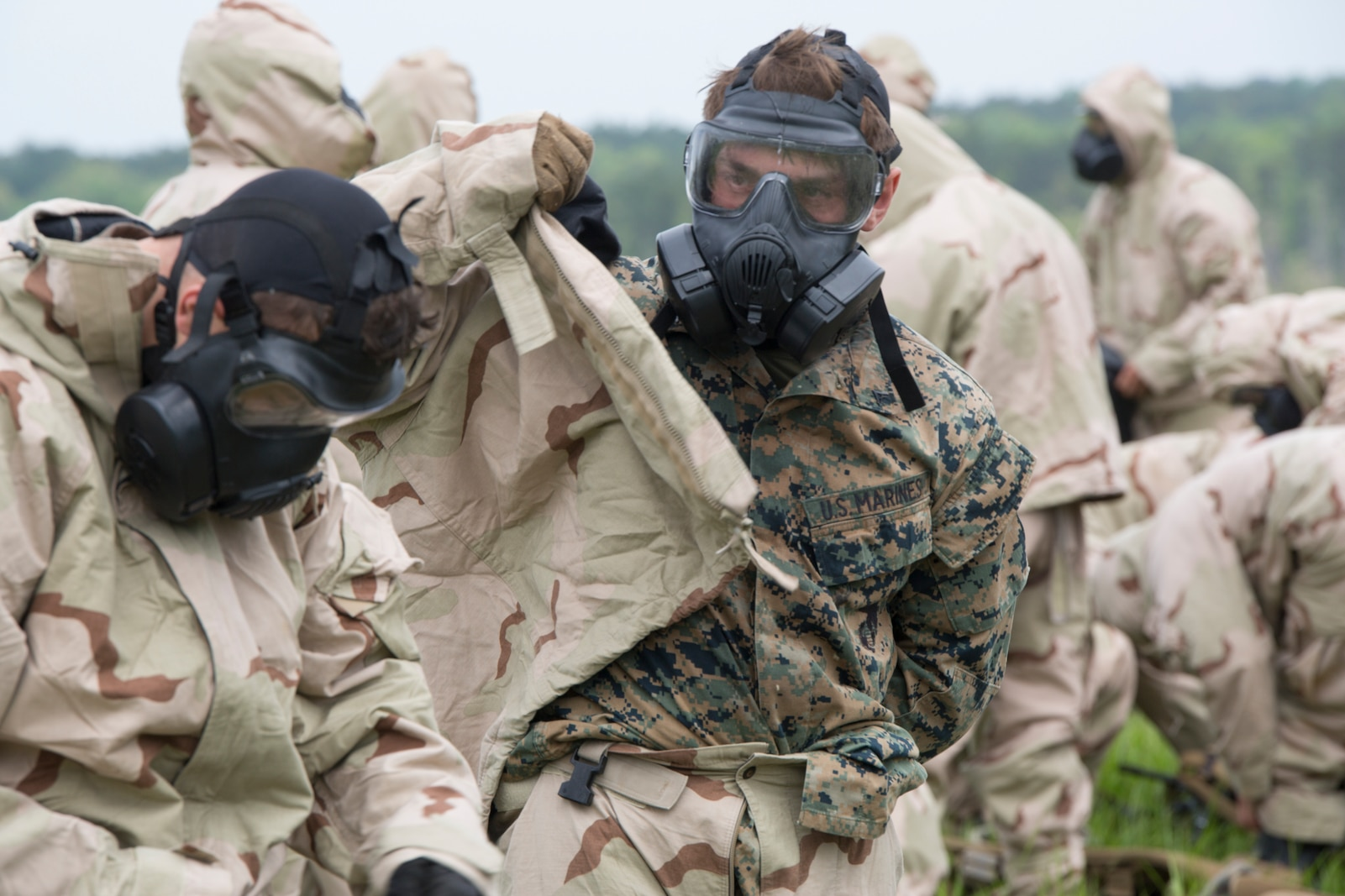 Marines prepare for a CBRN environment during the 1st Annual MCSFR Squad Competition