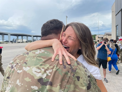 About 100 members from the 202nd RED HORSE Squadron, based at Camp Blanding Joint Training Center, FL, returned to the 125th Fighter Wing, Jacksonville, FL, following an 8-month deployment to the middle east. The unit was deployed to Al Udeid Air Base, Qatar, in support of Operation Freedom's Sentinel. They accomplished multiple air base/air facility, hangar, runway and other heavy engineer repair and construction projects throughout the U.S. Central Command area of responsibility. (U.S. Air National Guard photo by Tech. Sgt. Chelsea Smith)