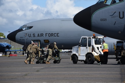 Airmen from the Iowa Air National Guard's 185th Air Refueling Wing move a fuel system icing inhibitor cart in place to begin refueling a U.S. Air Force KC-135 on the flight line at the Glasgow Prestwick International Airport, Scotland, May 18, 2021. The portable fuel injection system is used to add deicing fuel additive during ground refueling. Air Guard Airmen and their refueling aircraft are in Scotland providing air refueling support as part of NATO exercise Formidable Shield.