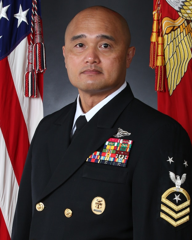 """Command Master Chief Rebana, enlisted in the United States Navy in April 1994 from San Diego, CA.  Following completion of basic training at Recruit Training Command Great Lakes, IL he reported to Hospital Corpsman """"A"""" School in Great Lakes, IL.   Sea duty assignments include 3d Battalion 7th Marines 29 Palms, CA; 3d Battalion 6th Marines, 6th Marine Regiment, and Headquarters Battalion, 2d Marine Division Camp Lejeune, NC; 3d Medical Battalion Okinawa, Japan; 2d Marine Logistics Group Camp Lejeune, NC.   Shore assignments include Naval Hospital Jacksonville, FL; Recruit Training Command Great Lakes, IL; Naval Hospital Camp Lejeune, NC; Naval Hospital Camp Pendleton, CA.   Operational deployments include Okinawa, Japan under the Unit Deployment Program (UDP); 3d Battalion 6th Marines, Al Qaim, Iraq in support of Operation Iraqi Freedom (OIF) III; 3d Battalion 6th Marines, Habbaniyah, Iraq in support of OIF 06-08; Regimental Combat Team-6, Ramadi, Iraq in support of OIF 09.1.    Command Master Chief Rebana is a graduate of the Navy Senior Enlisted Academy Class 161, Command Master Chief/Chief of the Boat Course Class 132, Keystone Course, and is Enlisted Fleet Marine Force Warfare qualified.  He has served in various leadership billets and as the Command Master Chief of 3d Medical Battalion, 2d Marine Logistics Group, and 2d Marine Division.     His decorations include the Legion of Merit, Meritorious Service Medal (4 awards), Navy and Marine Corps Commendation Medal (3 awards), Navy and Marine Corps Achievement Medal (4 awards), Combat Action Ribbon, and various unit awards."""