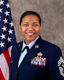 Chief Master Sgt. Adrienne Warren's official Air Force biography photo, looking at the camera in Air Force blues.