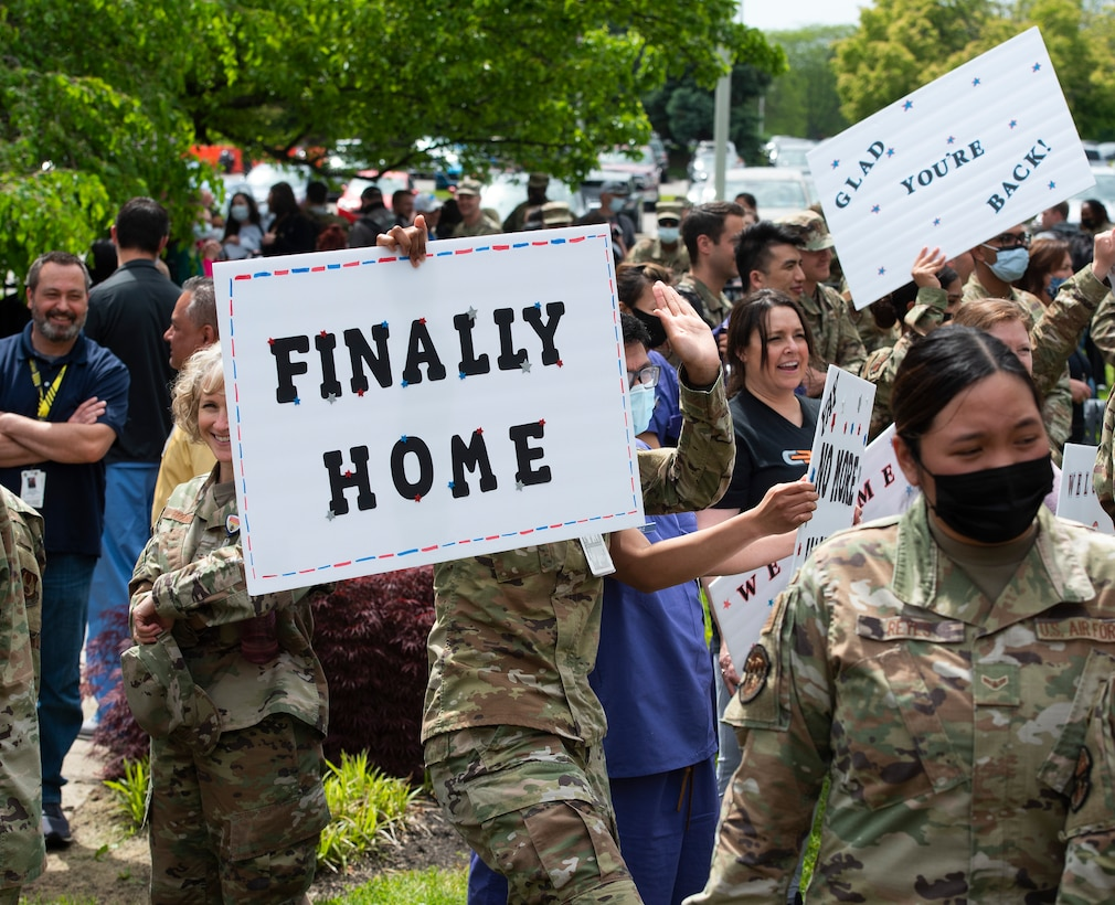 88th Medical Group Airmen gather May 18, 2021, at the Wright- Patterson Air Force Base, Ohio, Medical Center to welcome home friends and coworkers returning from atwo-month deployment to Detroit . The returning Airmen helped administer more than 200,000 doses of the COVID-19 vaccineto Michigan residents. (U.S. Air Force photo by R.J. Oriez)