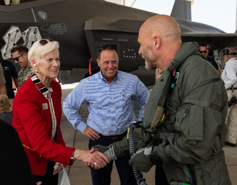 """Georgia Lord, Goodyear mayor, greets Royal Danish Air Force pilot """"MON,"""" 308th Fighter Squadron F-35 test pilot, after his first flight in a Danish F-35, May 5, 2021, at Luke Air Force Base, Arizona."""