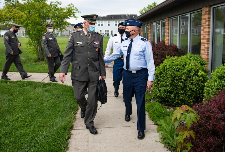 Col. Sasa Milutinovic, head of religious services for the Serbian Armed Forces, and Col. Kim Bowen, 88th Air Base Wing chaplain, talk as they walk into the Prairies Chapel Community Center at Wright-Patterson Air Force Base, Ohio, May 11, 2021. Milutinovic, along with four other Serbian chaplains, visited the base with Col. Daniel Burris, chaplain for the Ohio National Guard's Special Troops Command, as well as others in the Ohio chaplain delegation. (U.S. Air Force Photo by Wesley Farnsworth)