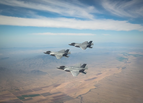 A U.S. Air Force, a Royal Danish Air Force and a Royal Netherlands Air Force F-35A Lightning II fighter jet assigned to the 308th Fighter Squadron, Luke Air Force Base, Arizona, fly in formation May 5, 2021, over Bagdad, Arizona.