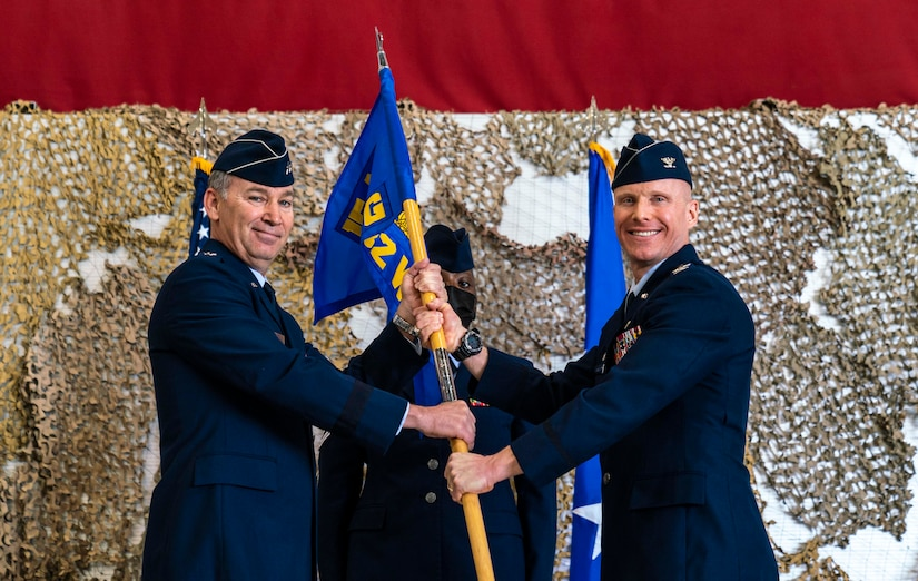 Col. Eric Schmidt receives command as he is passed the 432nd Wing/432nd Air Expeditionary Wing guidon.
