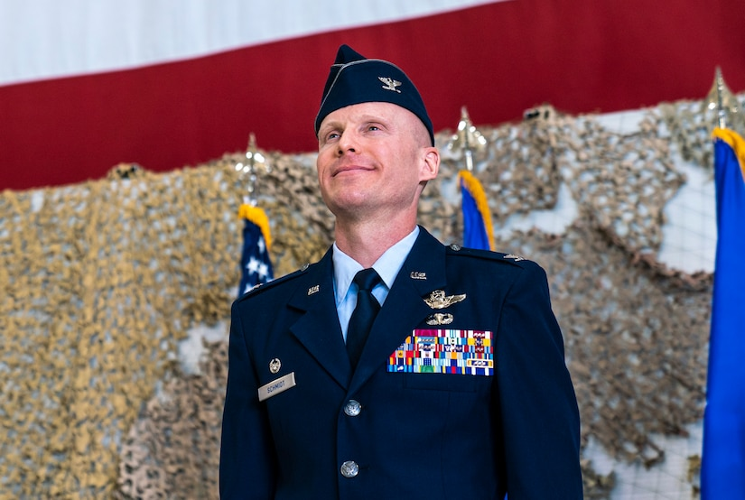 Col. Schmidt smiles after he is announced as the new commander of the 432nd Wing/432nd Air Expeditionary Wing.