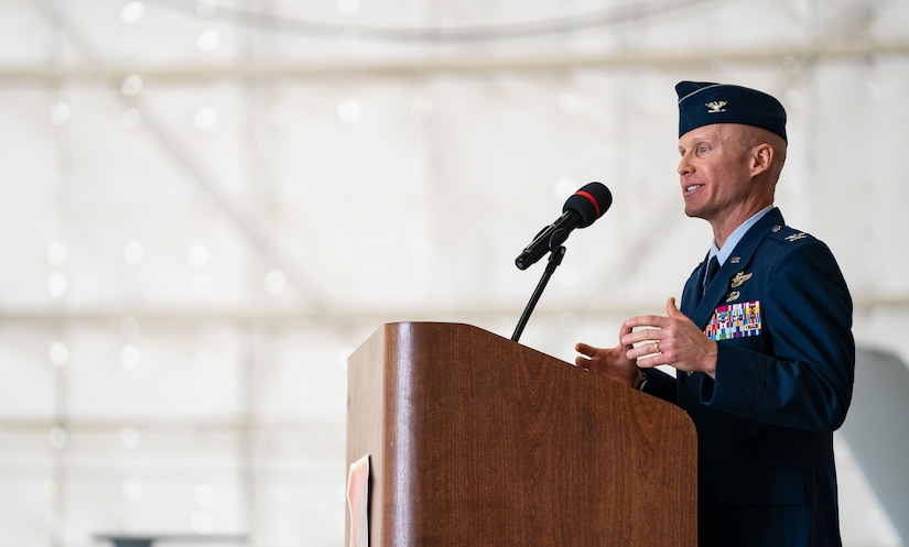 Col. Eric Schmidt, incoming 432nd Wing/432nd Air Expeditionary Wing commander, gives his remarks at a podium during the Wing change of command ceremony at Creech Air Force Base, Nevada, May 20, 2021.