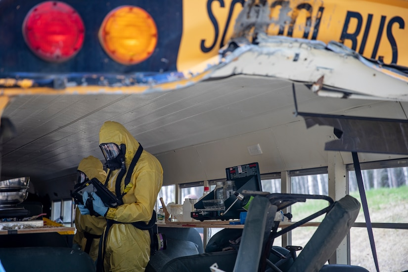 Staff Sgt. Logan Gladfeather and Tech. Sgt. David Hurst, team members of the 52nd Civil Support Team, Ohio National Guard, survey a bus at the Mat-Su Fire Training Center in Wasilla, Alaska, May 19, during Exercise ORCA 2021. ORCA is a chemical, biological, radioactive, nuclear threats response exercise designed for participants to provide support in the aftermath of hazardous materials incidents. ORCA tests interoperability between agencies, increases opportunities for working relationships, and practices requests for assistance methods. Approximately 250 National Guardsmen from CST units in Alaska, California, Connecticut, Colorado, Idaho, Ohio, Oregon, Rhode Island, South Carolina, South Dakota, Washington, and Wisconsin are in Alaska to participate in Exercise ORCA 2021. Numerous support units and civilian agencies participated in the exercise as well. (U.S. Army National Guard photo by Edward Eagerton)