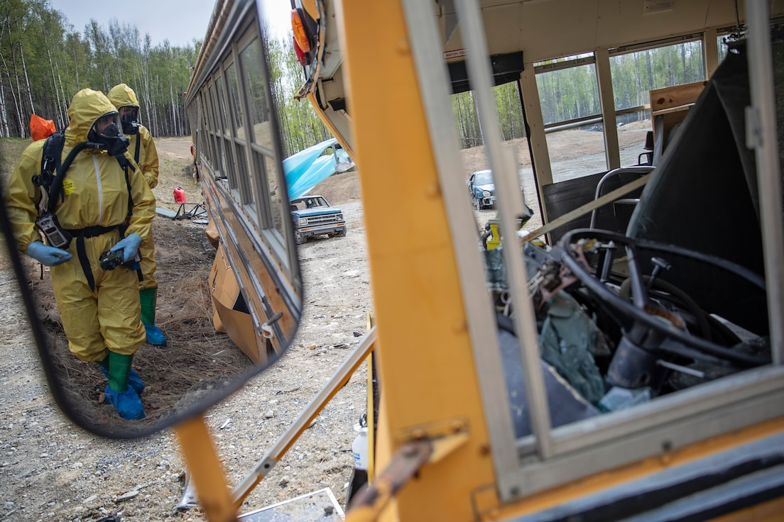 Tech. Sgt. David Hurst and Staff Sgt. Logan Gladfeather, team members of the 52nd Civil Support Team, Ohio National Guard, survey a bus at the Mat-Su Fire Training Center in Wasilla, Alaska, May 19, during Exercise ORCA 2021. ORCA is a chemical, biological, radioactive, nuclear threats response exercise designed for participants to provide support in the aftermath of hazardous materials incidents. ORCA tests interoperability between agencies, increases opportunities for working relationships, and practices requests for assistance methods. Approximately 250 National Guardsmen from CST units in Alaska, California, Connecticut, Colorado, Idaho, Ohio, Oregon, Rhode Island, South Carolina, South Dakota, Washington, and Wisconsin are in Alaska to participate in Exercise ORCA 2021. Numerous support units and civilian agencies participated in the exercise as well. (U.S. Army National Guard photo by Edward Eagerton)