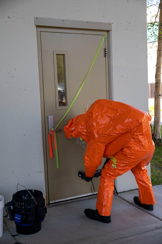 Tech Sgt. Eric McComb, 103rd Civil Support Team, prepares to enter a building to respond to a simulated incident at a parking garage on the University of Alaska Anchorage campus May 18 in support of Exercise ORCA 2021. ORCA is a chemical, biological, radioactive, nuclear threats response exercise designed for participants to provide support in the aftermath of hazardous materials incidents. ORCA tests interoperability between agencies, increases opportunities for working relationships, and practices requests for assistance methods. Approximately 250 National Guardsmen from CST units in Alaska, California, Connecticut, Colorado, Idaho, Ohio, Oregon, Rhode Island, South Carolina, South Dakota, Washington, and Wisconsin are in Alaska to participate in Exercise ORCA 2021. Numerous support units and civilian agencies participated in the exercise as well. (U.S. Army National Guard photo by Spc. Grace Nechanicky)