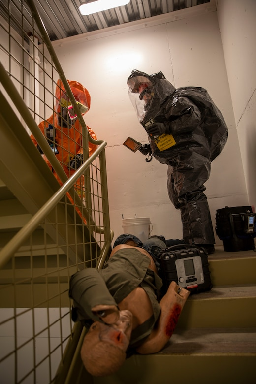 Tech Sgt. Eric McComb, 103rd Civil Support Team, and Sgt. Andrew Hunt, 103rd CST, respond to a simulated incident at a parking garage on the University of Alaska Anchorage campus May 18 in support of Exercise ORCA 2021. ORCA is a chemical, biological, radioactive, nuclear threats response exercise designed for participants to provide support in the aftermath of hazardous materials incidents. ORCA tests interoperability between agencies, increases opportunities for working relationships, and practices requests for assistance methods. Approximately 250 National Guardsmen from CST units in Alaska, California, Connecticut, Colorado, Idaho, Ohio, Oregon, Rhode Island, South Carolina, South Dakota, Washington, and Wisconsin are in Alaska to participate in Exercise ORCA 2021. Numerous support units and civilian agencies participated in the exercise as well. (U.S. Army National Guard photo by Spc. Grace Nechanicky)