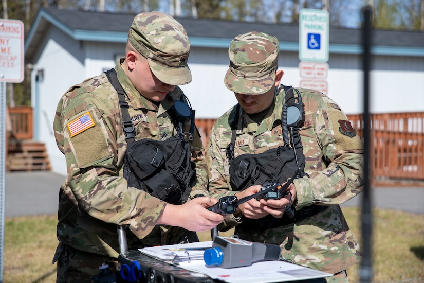 Sgt. Andrew Hunt, 103rd Civil Support Team, and Tech Sgt. Eric McComb, 103rd CST, prepare gear to respond to a simulated incident at a parking garage on the University of Alaska Anchorage campus May 18 in support of Exercise ORCA 2021. ORCA is a chemical, biological, radioactive, nuclear threats response exercise designed for participants to provide support in the aftermath of hazardous materials incidents. ORCA tests interoperability between agencies, increases opportunities for working relationships, and practices requests for assistance methods. Approximately 250 National Guardsmen from CST units in Alaska, California, Connecticut, Colorado, Idaho, Ohio, Oregon, Rhode Island, South Carolina, South Dakota, Washington, and Wisconsin are in Alaska to participate in Exercise ORCA 2021. Numerous support units and civilian agencies participated in the exercise as well. (U.S. Army National Guard photo by Spc. Grace Nechanicky)
