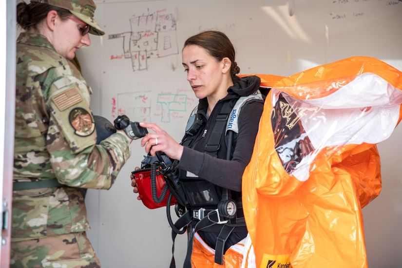 Sgt. Fabiana Kirtley, 103rd Civil Support Team, suits up as a back-up team member for a simulated incident at the Anchorage Fire Training Center, May 19, in support of Exercise ORCA 2021. ORCA is a chemical, biological, radioactive, nuclear threats response exercise designed for participants to provide support in the aftermath of hazardous materials incidents. ORCA tests interoperability between agencies, increases opportunities for working relationships, and practices requests for assistance methods. Approximately 250 National Guardsmen from CST units in Alaska, California, Connecticut, Colorado, Idaho, Ohio, Oregon, Rhode Island, South Carolina, South Dakota, Washington, and Wisconsin are in Alaska to participate in Exercise ORCA 2021. Numerous support units and civilian agencies participated in the exercise as well. (U.S. Army National Guard photo by Spc. Grace Nechanicky)