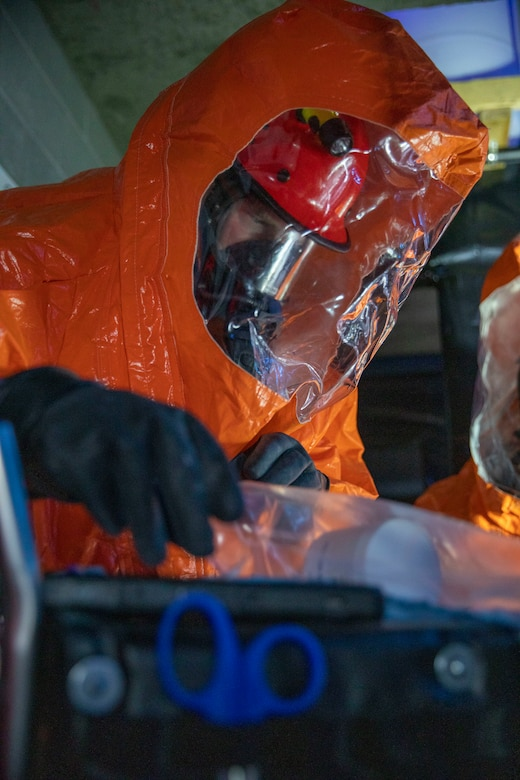 Sgt. Anthony Luiken, 103rd Civil Support Team, and Staff Sgt. Jonathan Ramos, 103rd CST, collect and seal samples at a simulated incident at the Anchorage Fire Training Center, May 19, in support of Exercise ORCA 2021. ORCA is a chemical, biological, radioactive, nuclear threats response exercise designed for participants to provide support in the aftermath of hazardous materials incidents. ORCA tests interoperability between agencies, increases opportunities for working relationships, and practices requests for assistance methods. Approximately 250 National Guardsmen from CST units in Alaska, California, Connecticut, Colorado, Idaho, Ohio, Oregon, Rhode Island, South Carolina, South Dakota, Washington, and Wisconsin are in Alaska to participate in Exercise ORCA 2021. Numerous support units and civilian agencies participated in the exercise as well. (U.S. Army National Guard photo by Spc. Grace Nechanicky)