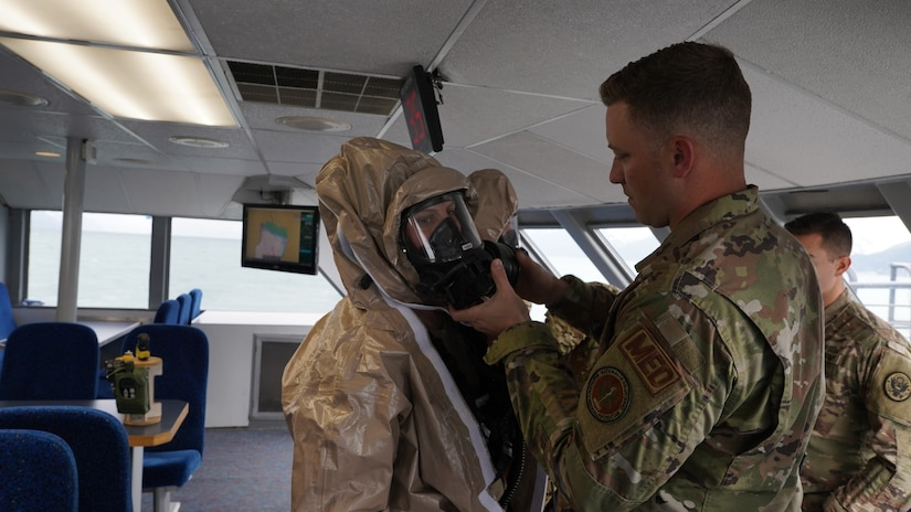 Tech. Sgt. Dennis Haubrich Medical noncommissioned officer assigned to the 13th Civil Support team, Rhode Island National Guard, inspects the filter element attached to the initial response team member's facemask prior to his entry into the simulated incident site aboard the Glacier Express vessel cruising through Resurrection Bay off of the coast of Seward, Alaska, May 19, in support of Exercise ORCA 21. ORCA is a chemical, biological, radioactive, nuclear threats response exercise designed for participants to provide support in the aftermath of hazardous materials incidents. ORCA tests interoperability between agencies, increases opportunities for working relationships, and practices requests for assistance methods. Approximately 250 National Guardsmen from CST units in Alaska, California, Connecticut, Colorado, Idaho, Ohio, Oregon, Rhode Island, South Carolina, South Dakota, Washington, and Wisconsin are in Alaska to participate in Exercise ORCA 2021. Numerous support units and civilian agencies participated in the exercise as well. (U.S. Army National Guard photo by Dana Rosso)