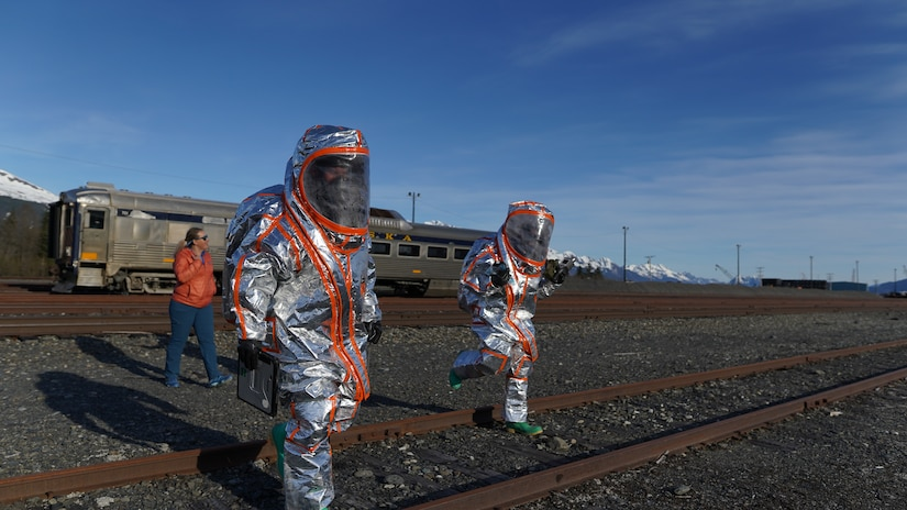Team members of the 102nd Civil Support Team from the Oregon National Guard transition to the decontamination area after responding to a simulated incident at the Alaska Railroad train yard in Seward, Alaska, May 18, in support of Exercise ORCA 21. ORCA is a chemical, biological, radioactive, nuclear threats response exercise designed for participants to provide support in the aftermath of hazardous materials incidents. ORCA tests interoperability between agencies, increases opportunities for working relationships, and practices requests for assistance methods. Approximately 250 National Guardsmen from CST units in Alaska, California, Connecticut, Colorado, Idaho, Ohio, Oregon, Rhode Island, South Carolina, South Dakota, Washington, and Wisconsin are in Alaska to participate in Exercise ORCA 2021. Numerous support units and civilian agencies participated in the exercise as well. (U.S. Army National Guard photo by Dana Rosso)