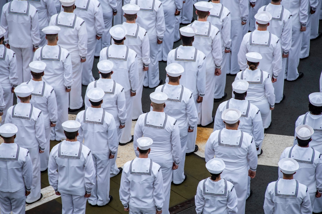 210519-N-WS494-1026 YOKOSUKA, Japan (May 19, 2021) Sailors prepare to man the rails on the flight deck of the U.S. Navy's only forward-deployed aircraft carrier USS Ronald Reagan (CVN 76) as it departs Commander, Fleet Activities Yokosuka, Japan. Ronald Reagan, the flagship of Carrier Strike Group Five, provides a combat-ready force that protects and defends the United States, as well as the collective maritime interests of its allies and partners in the Indo-Pacific region. (U.S. Navy photo by Mass Communication Specialist 3rd Class Quinton A. Lee)