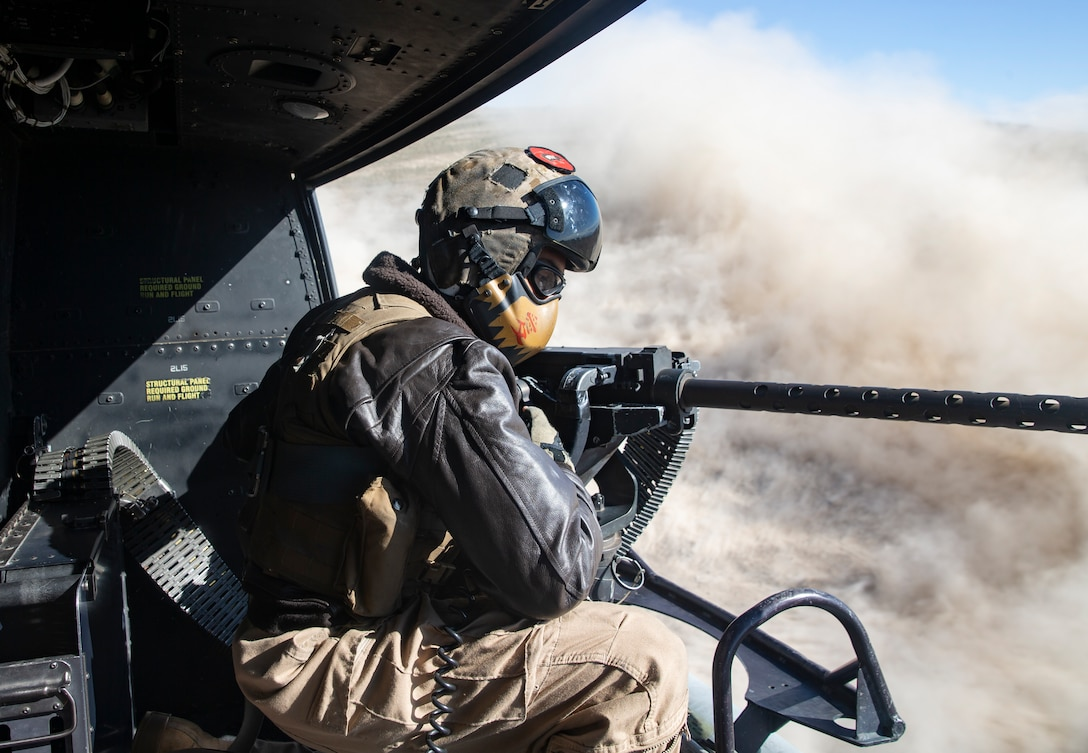 U.S. Marine Corps Sgt. Sergio Ramos, a crew chief with Marine Light Attack Helicopter Squadron (HMLA) 167, looks outside of the UH-1Y Venom helicopter at Gowen Field, Boise, Idaho, May 2, 2021. Marines with HMLA-167 are training in challenging high altitude conditions in order to maintain combat readiness while integrating with local joint forces. HMLA-167 is a subordinate unit of 2nd Marine Aircraft Wing, the aviation combat element of II Marine Expeditionary Force. (U.S. Marine Corps photo by LCpl. Yuritzy Gomez)