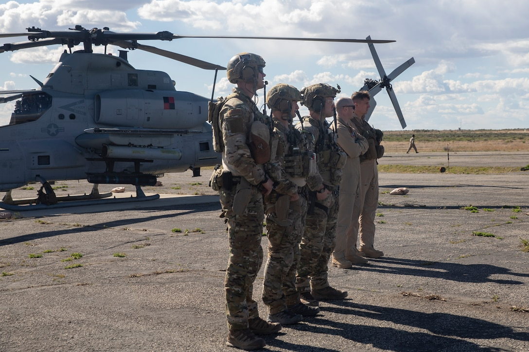 U.S. Marines with Marine Light Attack Helicopter Squadron (HMLA) 167 and U.S. Airmen assigned to the 124th Air Support Operations Squadron prepare to receive a brief at Gowen Field, Boise, Idaho, May 10, 2021. Marines with HMLA-167 are training in challenging high altitude conditions in order to maintain combat readiness while integrating with local joint forces. HMLA-167 is a subordinate unit of 2nd Marine Aircraft Wing, the aviation combat element of II Marine Expeditionary Force. (U.S. Marine Corps photo by LCpl. Yuritzy Gomez)